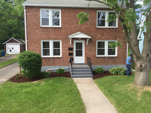 fresh flower beds lend curb appeal